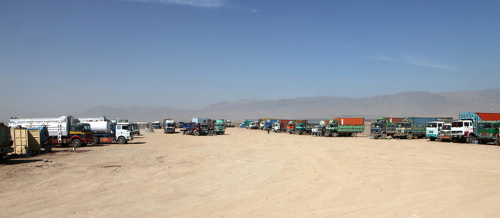 trucks with supplies are checked for explosions outside ISAF base, Uruzgan, Afghanistan