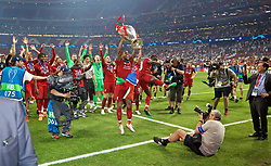 MADRID, SPAIN - SATURDAY, JUNE 1, 2019: Liverpool's Georginio Wijnaldum lifts the trophy after the UEFA Champions League Final match between Tottenham Hotspur FC and Liverpool FC at the Estadio Metropolitano. Liverpool won 2-0 to win their sixth European Cup. (Pic by David Rawcliffe/Propaganda)