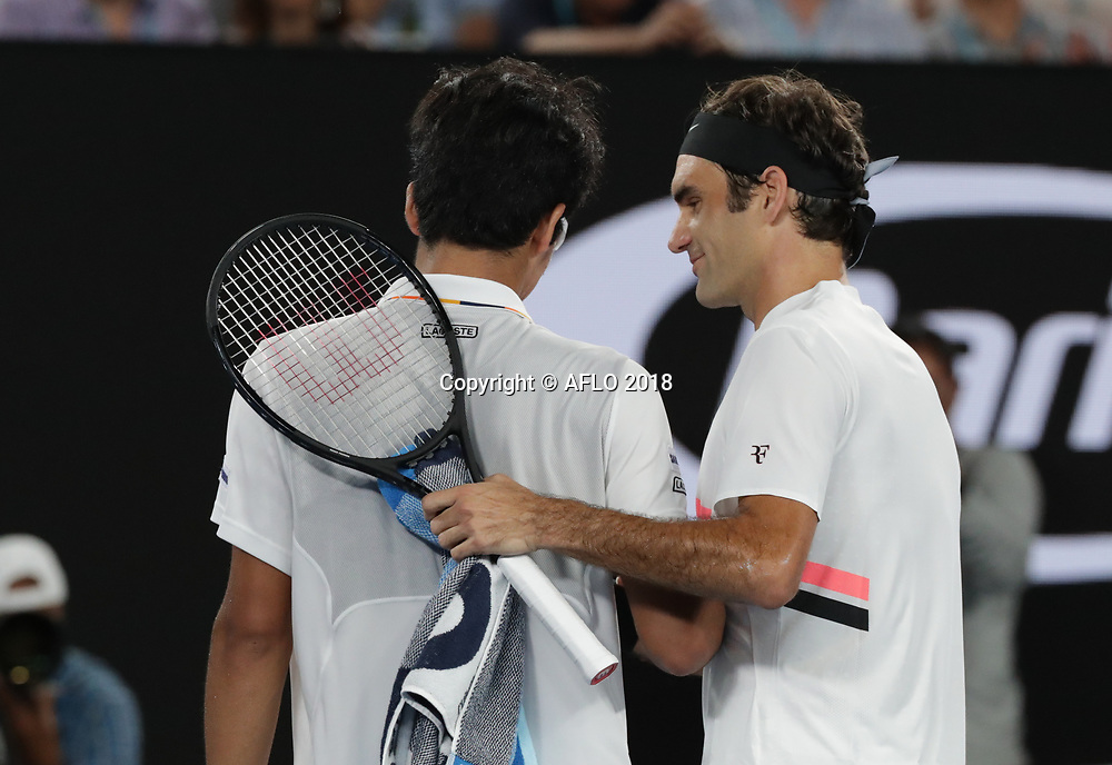 Swiss tennis player Roger Federer consoles Hyeon Chung after Chung retires injured from the semi finals match at the Australian Open on Jan 26, 2018 in Melbourne, Australia. (Photo by YAN LERVAL/AFLO)