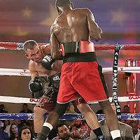 Inka Laley (R) punches Eric Pinero during a Telemundo Boxeo boxing match at the A La Carte Pavilion on Friday, March 13, 2015 in Tampa, Florida.  Laley won the bout. (AP Photo/Alex Menendez)