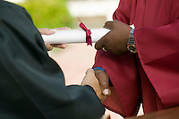 Graduate Receiving Diploma and Handshake