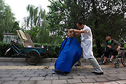 One of just a few remaining traditional cycling hair cutters along a side road (near the Second Ring Road) popular with cyclists - Old Beijing Bike Culture -- 2011 Tour of Beijing Scouting Photos