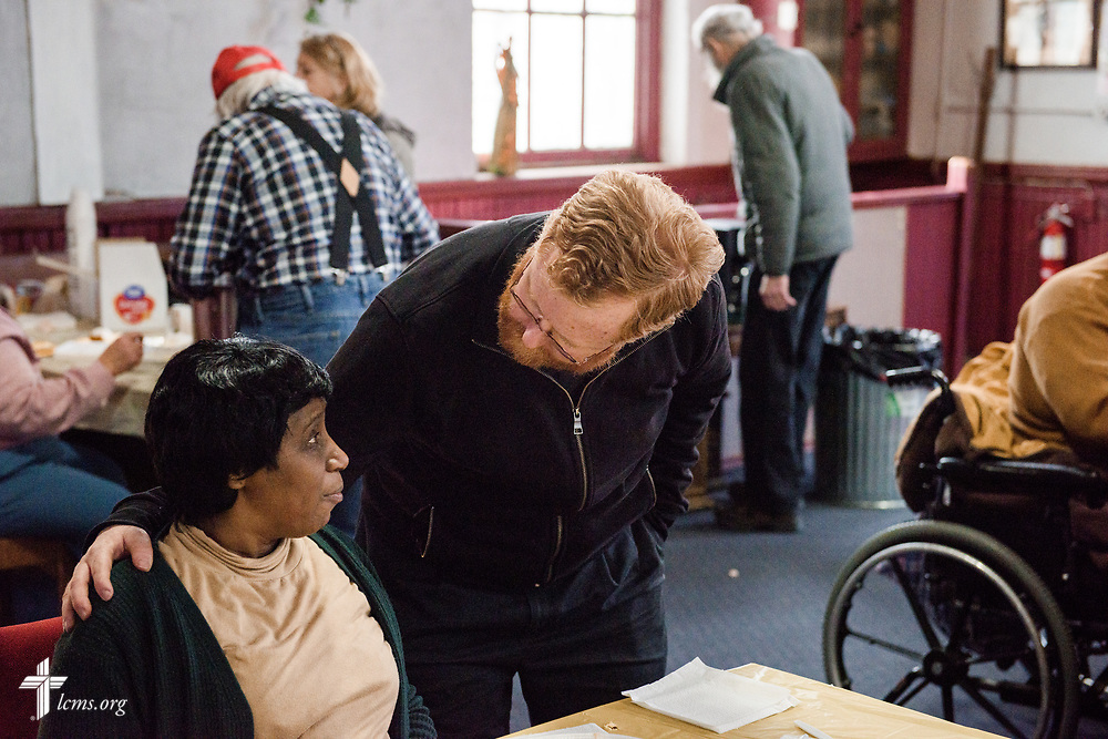 The Rev. Roy Axel Coats, pastor of Lutheran Church of the Redeemer, Baltimore, greets members in the Lutheran Outreach Center for the Blind during a monthly meal at St. Thomas Lutheran Church, Baltimore, on Saturday, March 24, 2018. LCMS Communications/Erik M. Lunsford