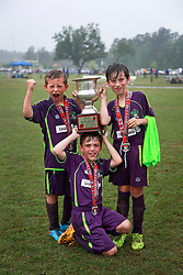 12 April 2015. Hammond, Louisiana.<br /> New Orleans Jesters Champions! <br /> Ben, Paddy and Max with the cup. U9 New Orleans Jesters Elites, team purple defeat U10 PAC Piranhas 5-1 to win their division against U10 teams in the Strawberry Cup hosted by the South Tangipahoa Youth Soccer Association (STYSA).<br /> Photo; Charlie Varley/varleypix.com