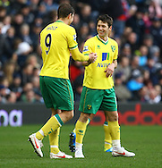 Picture by Paul Chesterton/Focus Images Ltd.  07904 640267.28/01/12.Grant Holt of Norwich City opens the scoring and celebrates with Wes Hoolahan during the FA Cup fourth round match at The Hawthorns Stadium, West Bromwich.