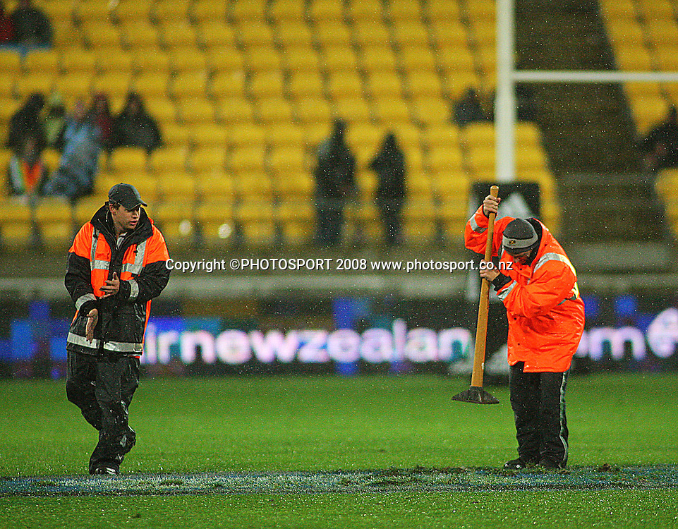 Stewards flatten out ripped-up turf during a break in play.<br /> International Test Match - All Blacks v Ireland, Westpac Stadium, Wellington. Saturday 7 June 2008. Photo: Dave Lintott/PHOTOSPORT