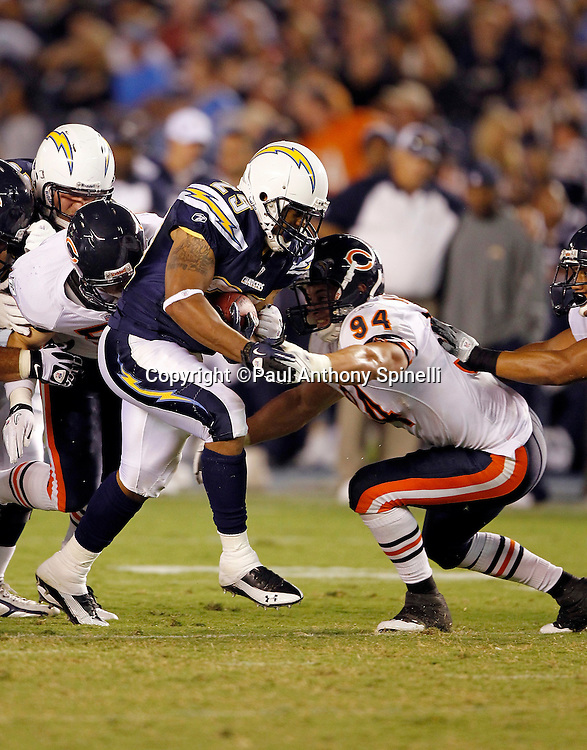 San Diego Chargers running back Marcus Mason (29) dodges a tackle attempt by Chicago Bears rookie linebacker Matt Mayberry (94) as he runs the ball after catching a pass during a NFL week 1 preseason football game against the Chicago Bears, Saturday, August 14, 2010 in San Diego, California. The Chargers won the game 25-10. (©Paul Anthony Spinelli)