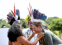 Prince Harry is given is presented with a headdress by dancers in Sumara Village in the Guyana Hinterland in Sumara, Guyana, as part of his tour of the Caribbean.