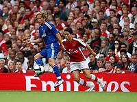 Photo: Richard Lane/Richard Lane Photography. Arsenal v Real Madrid. Emirates Cup. 03/08/2008. Arsenal's Samir Nasri (rt) challenges Real's Michel Salgado.