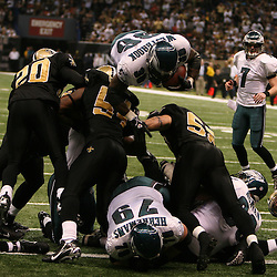13 January 2007: Philadelphia Eagles running back Brian Westbrook (36) leaps over a trio of New Orleans Saints defenders for a touchdown during a 27-24 win by the New Orleans Saints over the Philadelphia Eagles in the NFC Divisional round playoff game at the Louisiana Superdome in New Orleans, LA. The win advanced the New Orleans Saints to the NFC Championship game for the first time in the franchise's history.