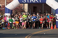 Cornwall-on-Hudson, New York - Runners take off at the start of the Cornwall Lions Club Fall Harvest Race 5K on Nov. 10, 2013.