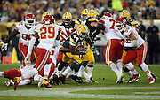 Green Bay Packers running back James Starks (44) tries to break out of a group of players surrounding him on a running play during the 2015 NFL week 3 regular season football game against the Kansas City Chiefs on Monday, Sept. 28, 2015 in Green Bay, Wis. The Packers won the game 38-28. (©Paul Anthony Spinelli)