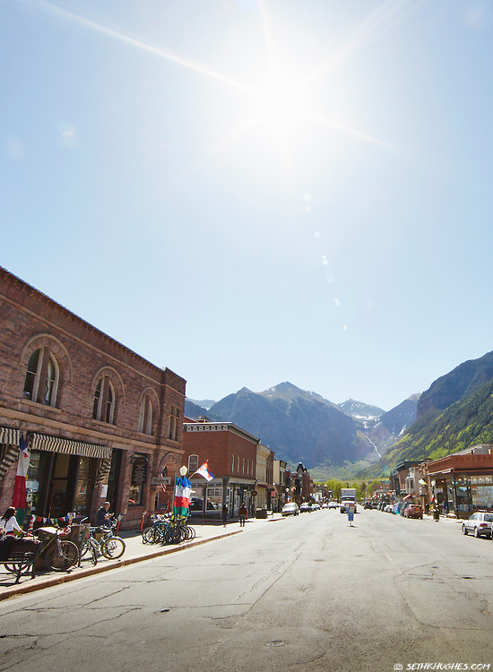 Telluride's rural charm seen from Colorado Avenue on crisp summer morning.