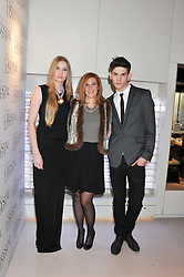 Left to right, FREYA McHUGH,  ELIZABETH STARK of Swarovski and REECE SANDERS at the unveiling of the Helena Christensen and Swarovski Crystallized Unsigned Model search winners held at Swarovski Crystallized, 24 Great Marlborough Street, London on 26th January 2012.
