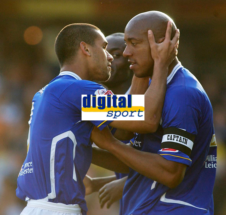 Photo: Daniel Hambury.<br />Watford v Leicester City. Coca Cola Championship.<br />15/10/2005.<br />Leicester's Patrick Kisnorbo celebrates scoring the second goal by kissing his captain, Dion Dublin.
