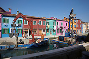 Burano island. Sidewalks along a channel are elevated by around half a meter to prevent floodings due to rising sea levels. New water pipes and sewers are also installed in the process.