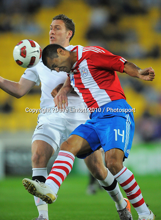 Paraguay's Paula Da Silva heads the ball away from Chris Killen. International football friendly - New Zealand All Whites v Paraguay at Westpac Stadium, Wellington on Tuesday, 12 October 2010. Photo: Dave Lintott / photosport.co.nz
