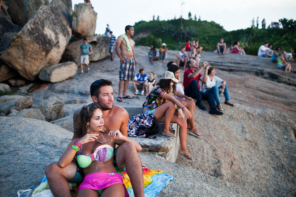 A couple hang out at Arproador during the sunset, in Rio de Janeiro, Brazil, on Feb. 2, 2013. The point is popular for sunset watching.