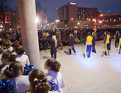 West Virginia cheerleads are seen on stage during a pep rally in downtown Memphis.