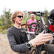 Óliver Hilmarsson and Jökull Bergmann packing after mountain biking at Þverá, Skíðadalur, North, Iceland.