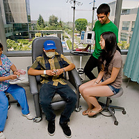 Michael Miyamoto gets blood work done by RN Bella De Guzman,left, with his sister Jaclyn and friend Jason Adauto during a visit to City of Hope in Duarte, Thursday, June 23, 2011. Miyamoto has recently relapsed for a third time in his battle with Leukemia and is undergoing radition and chemotherapy treatments at City of Hope. Michael, who was first diagnosed when he was 7, is participating for the fourth time in the Walnut Relay for Life, set for this weekend at Mt. SAC.  (SGVN/Eric Reed/Staff Photographer/SVCITY)