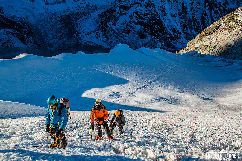 A party of climbers start the ascent of the main Ice Wall on Island Peak.
