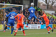 AFC Wimbledon defender Deji Oshilaja (4) with a header on goal during the The FA Cup 5th round match between AFC Wimbledon and Millwall at the Cherry Red Records Stadium, Kingston, England on 16 February 2019.