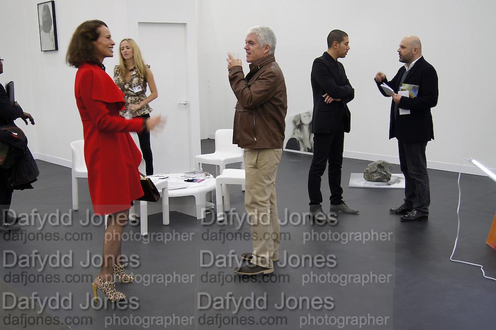 ANDREA DELLAL; TIM BLANKS, opening of the 2010 Frieze art fair. Regent's Park. London. 13 October 2010. -DO NOT ARCHIVE-© Copyright Photograph by Dafydd Jones. 248 Clapham Rd. London SW9 0PZ. Tel 0207 820 0771. www.dafjones.com.