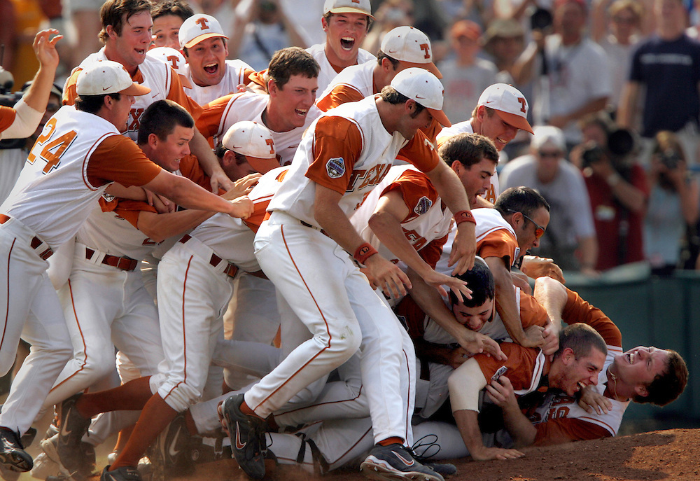 College World Series - The University of Texas baseball team celebrates their College World Series championship victory over the University of Florida June 26 at Rosenblatt Stadium in Omaha, Neb.