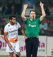 RAIPUR (India) - Umpire Adam Kearns of Australia. Semi Final in the  Hockey World League Final  men  INDIA v BELGIUM    © KOEN SUYK /TREEBYIMMAGES