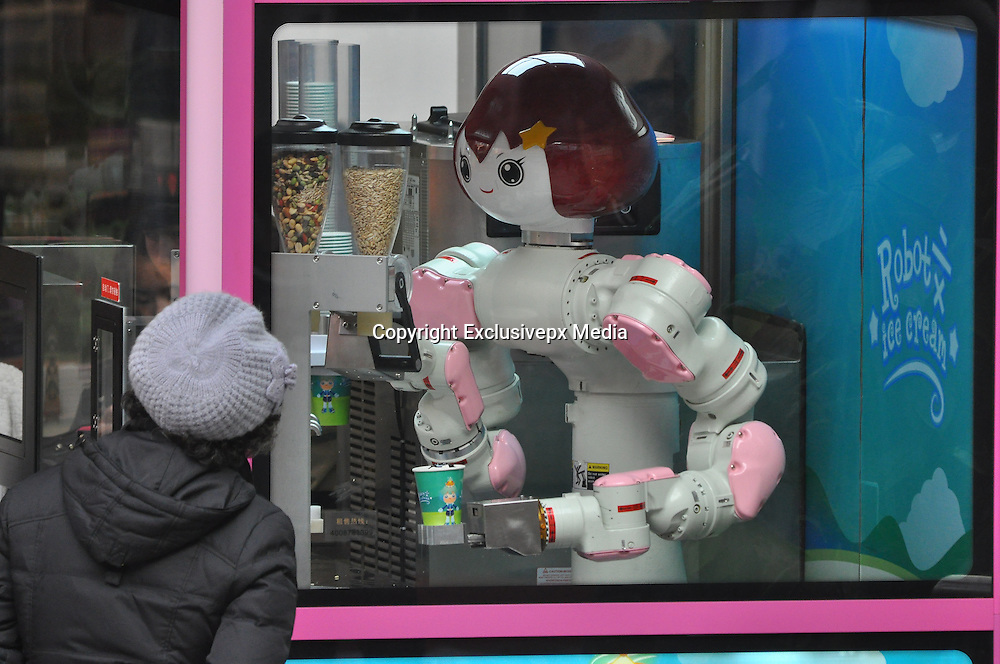 SHENYANG, CHINA - FEBRUARY 03: (CHINA OUT) <br /> <br /> Robot Ice Cream House Appears In Shenyang<br /> <br /> People circusee a robot ice cream house on February 3, 2015 in Shenyang, Liaoning province of China. A robot who can make 6 different flavors of ice creams attracted a lot of customers in Shenyang on Tuesday. <br /> &copy;Exclusivepx Media