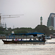 Sudanese take traditional ferries across the Nile River in Khartoum while cranes hover over new construction along the river's banks. While much of Sudan is experiencing an economic boom, and investors mainly from the Gulf countries and China, are flocking to Africa's largest country, the majority of the population remains poor.