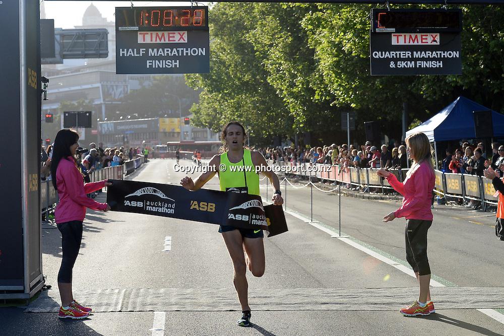 Hamish Carson of Wellington finishes the half-marathon race in 1h 8m 27s. ASB Auckland Marathon 2014,02 November 2014. Photo: Raghavan Venugopal/www.photosport.co.nz