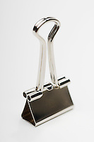 Binder clip on white background