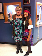 "Eastwood Academy Principal Paula Fendley and a student sport a ""Hippies for Peace"" theme.<br />