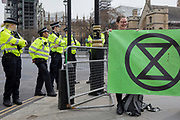 Police officers seal off Parliament Square during the week-long protest by climate change activists with Extinction Rebellion's campaign to block road junctions and bridges around the capital, on 23rd April 2019, in London England.