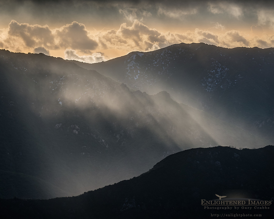Sunlit rain over mountain ridge in the Los Padres National Forest, Monterey County, California