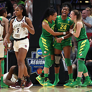 March 31, 2019; Portland, OR, USA; Oregon Ducks forward Ruthy Hebard (24) reacts after making a defensive play against the Mississippi State Bulldogs in the second half of Elite Eight of the NCAA Women's Tournament at Moda Center.<br /> Photo by Jaime Valdez