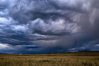 Dramatic rain clouds fill the Wet Mountain Valley near Westcliffe, Colorado
