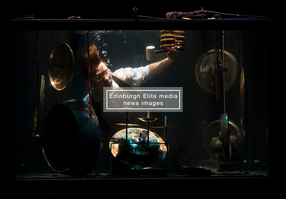 drummer Morten Poulsen performs with other musicians in water filled glass tanks as part of the Sonica 2017 Festival to be held in Glasgow from 26th October to 5th November this year.<br /> <br /> © Dave Johnston/ EEm