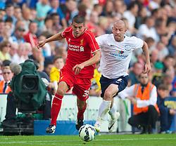 PRESTON, ENGLAND - Saturday, July 19, 2014: Liverpool's Conor Coady in action against Preston North End's Keith Keane during a preseason friendly match at Deepdale Stadium. (Pic by David Rawcliffe/Propaganda)