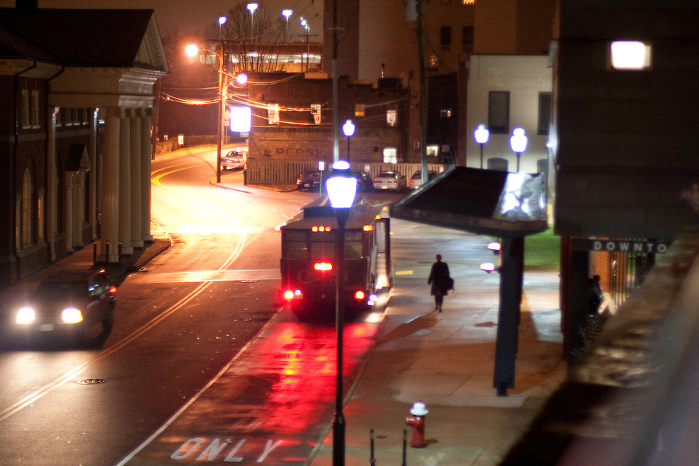 A passenger boards the free trolley in the evening, Downtown Transit Station, Charlottesville Virginia.
