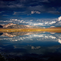 Sunrise at Big Alkali Lake )Near Mammoth Lakes, CA), storm clouds over the Sierra's with reflection in the lake.
