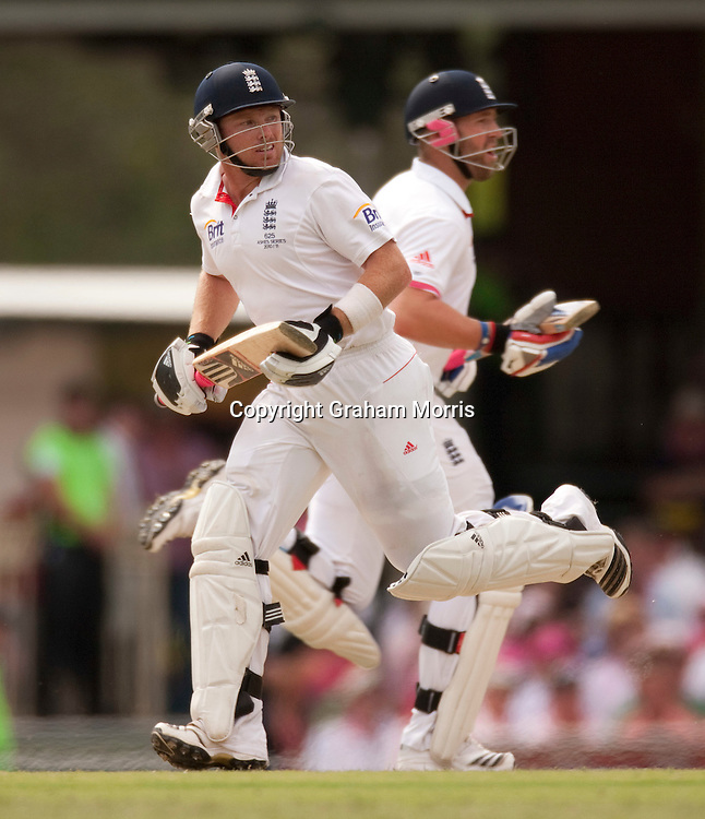 Ian Bell runs past Matt Prior (right) during his century in the fifth and final Ashes test match between Australia and England at the SCG in Sydney, Australia. Photo: Graham Morris (Tel: +44(0)20 8969 4192 Email: sales@cricketpix.com) 05/01/11