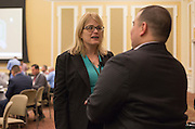 Amy Taylor-Bianco, an associate professor in the management systems department in Ohio University's College of Business, talk to Jacob Hiler, an assistant professor in the College of Business's marketing department, during lunch at the College of Business Center for Leadership Event in Baker Ballroom on April 23, 2016.