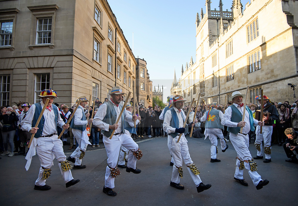 "© Licensed to London News Pictures. 01/05/2018. Oxford, UK. Morris dancers in dress dance underneath Hertford Bridge, often called ""the Bridge of Sighs""  in Oxford, Oxfordshire as part of May Day celebrations. Students were again prevented from jumping from Magdalen Bridge in to the river, which has historically been a tradition, due to injuries at a previous years event . Photo credit: Ben Cawthra/LNP"