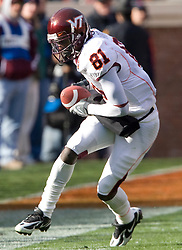 Virginia Tech wide receiver Justin Harper (81) makes a sideline catch.  The #8 ranked Virginia Tech Hokies defeated the #16 ranked Virginia Cavaliers 33-21 at Scott Stadium in Charlottesville, VA on November 24, 2007.