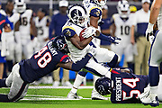 HOUSTON, TX - AUGUST 29:  Justin Davis #33 of the Los Angeles Rams runs the ball and is tackled by Travin Howard #48 and Bryce Hager #54 ofthe Houston Texans during week four of the preseason at NRG Stadium on August 29, 2019 in Houston, Texas. The Rams defeated the Texans 22-10.   (Photo by Wesley Hitt/Getty Images) *** Local Caption *** Justin Davis; Travin Howard; Bryce Hager