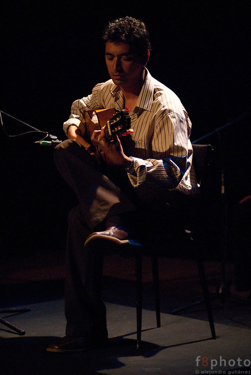 "The guitarrist Josue Tacoronte Otero during the guitar concert ""Tocando al Sentimiento"" in the Second International Dance Festival Ibérica Contemporánea, Querétaro, México, 2009"