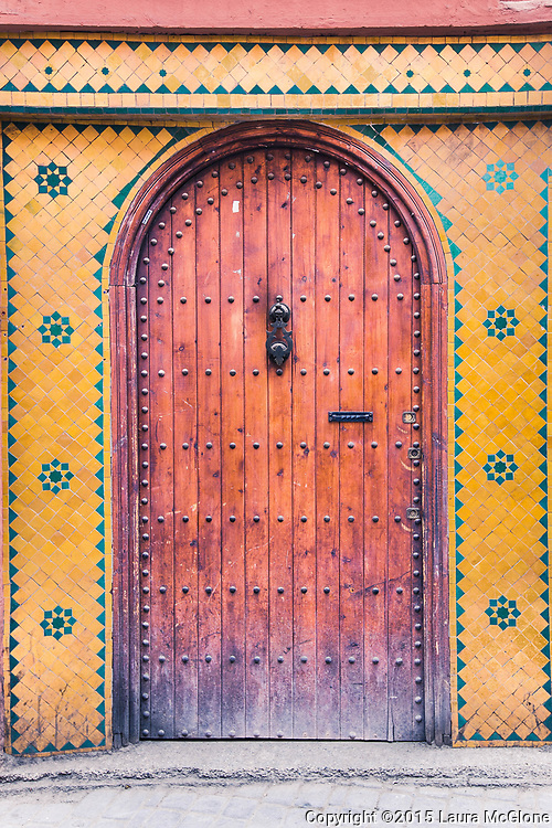 Moroccan Doorway with yellow & green tile surround, Morocco